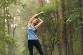 Healthy Lifestyle Fitness Sporty Woman Stretching Before Run In Forest Area