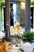 Winter decoration table using twigs, pine needles, gifts and gla