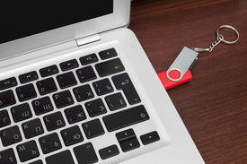 pic of backspace  - Flash memory drive plugged into a laptop port - JPG
