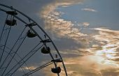 foto of ferris-wheel  - A Ferris Wheel at Dusk with a Magnificent Sky as it - JPG