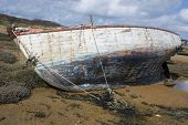 image of tide  - Old boat on the beach with low tide - JPG