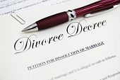 stock photo of divorce-papers  - legal divorce paper documents with pen closeup - JPG