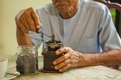picture of wooden box from coffee mill  - Asian senior man with vintage coffee grinder and coffee beans  - JPG