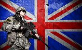 foto of soldier  - soldier holding rifle on a England flag background - JPG