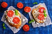 foto of tomato sandwich  - Sandwich with cheese tomato and Basil on paper - JPG
