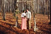 stock photo of wedding arch  - bride and groom in the wedding ceremony in forest near the decorate arch - JPG
