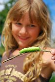 Young Girl With Big Green Caterpillar (focus On Caterpillar)