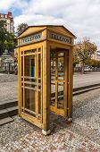image of phone-booth  - Yellow Phone Booth In Carlsbad in Czech Republic - JPG