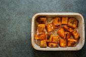 foto of pot roast  - Roasted pumpkin in a ceramic pot on a black slate background - JPG