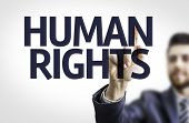foto of human rights  - Business man pointing the text - JPG