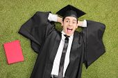 picture of graduation gown  - An excited student in graduation gown - JPG