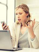 stock photo of pissed off  - picture of confused woman with cell phone - JPG