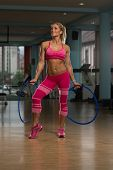 picture of hula hoop  - Middle Age Womane Playing Around With Hula Hoop Rings