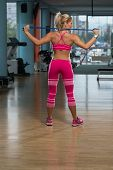 picture of jump rope  - Middle Age Womane Playing Around With Jumping Rope As Part Of Bodybuilding Training - JPG