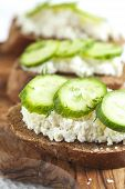 picture of spreader  - Sandwich With Fresh Cream Cheese, Cucumber And Pink Salt ** Note: Shallow depth of field - JPG