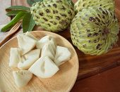 stock photo of custard  - custard apple Pieces are placed in a dish - JPG