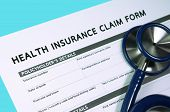 picture of reimbursement  - Health  and medical insurance claim form with stethoscope - JPG