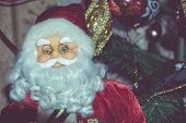 pic of accordion  - Christmas santa toy playing the accordion vintage photo effect background - JPG