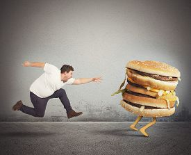 foto of grease  - Insatiable fat man runs for catch sandwich - JPG