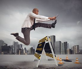 stock photo of hazardous  - Businessman distracted trying to overcome a hazard - JPG