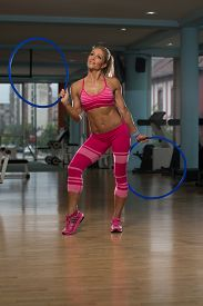 pic of hulahoop  - Middle Age Womane Playing Around With Hula Hoop Rings - JPG