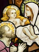 stock photo of holy family  - A cmpilation of stained glasses showing Holy Family - JPG