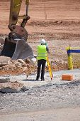 pic of cartographer  - Surveyor taking measurements at a construction site - JPG