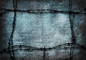 Blue Grunge Background Framed With Barbed Wire