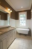 bathroom in affluent home with clawfoot tub