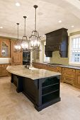 foto of opulence  - opulent kitchen with complimentary colored cabinets and granite island - JPG