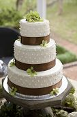 picture of cake stand  - wedding cake and bouquets on table - JPG