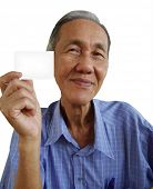 Senior chinese man showing and a business card
