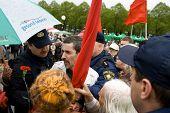 RIGA, LATVIA, MAY 9, 2009: Vladimir Linderman, member of the banned National Bolshevik party (NBP) is arrested for using forbidden Soviet Union flag