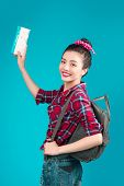 Woman Travel. Young Beautiful Asian Woman Traveler With Air Ticket On Blue Background poster