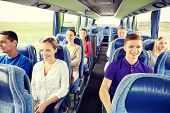 transport, tourism, road trip and people concept - group of happy passengers or tourists in travel b poster