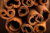 Cinnamon Sticks And Meal Close Up On Wooden Table. Cinnamon Sticks Spice Close Up Background. Textur poster