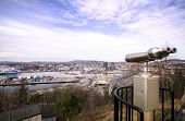 foto of peeping-tom  - View from ekeberg restaurant Oslo Norway with a telescope in the foreground - JPG