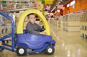 Child In The Toy Automobile