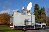 A North American TV news truck in the fall.