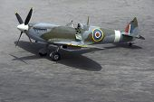 stock photo of spitfire  - A British Spitfire fighter plane stands ready for action on an oil - JPG