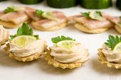 image of crudites  - Small toast filled with tuna salad and a small slice of lemon on top - JPG
