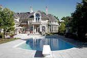 stock photo of swimming pool family  - Picture of a Luxury Home Swimming Pool and Back - JPG