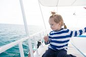 Summer Vacation Concept. Child With Blond Hair On Yacht On Sunny Day. Boy In Sailor Shirt Sail In Bl poster