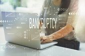 Bankruptcy With Woman Using Her Laptop In Her Home Office poster