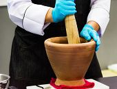Using A Mortar And Pestle To Pound Ingredients For Thai Food, Pound Mortar poster