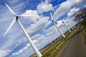 stock photo of wind-farm  - Windmills in wind - JPG