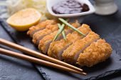 Japanese tonkatsu steak, breaded and fried pork cutlet served with shredded cabbage poster