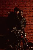 Sexy Couple. Sexy Couple With Motorbike. Sexy Couple On Red Brick Wall Background. Sexy Couple In Lo poster