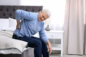 Senior Man Suffering From Back Pain At Home poster