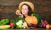 Child Celebrate Harvesting. Kid Farmer With Harvest Wooden Background. Family Farm Festival Concept. poster